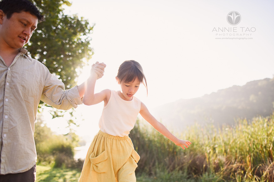 Bay-Area-lifestyle-family-photography-father-holding-daughters-hand-with-sunflare