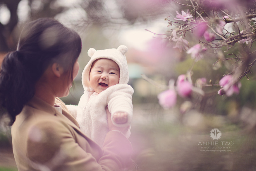 Bay-Area-Palo-Alto-lifestyle-family-photography-mom-holding-smiling-baby-through-japanese-cherry-blossoms