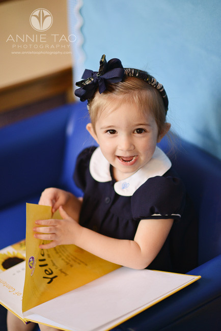 Commercial-education-photography-preschooler-girl-looking-up-in-mini-chair