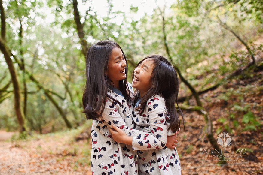 Bay-Area-lifestyle-children-photography-sisters-hugging-and-laughing-in-woods-2