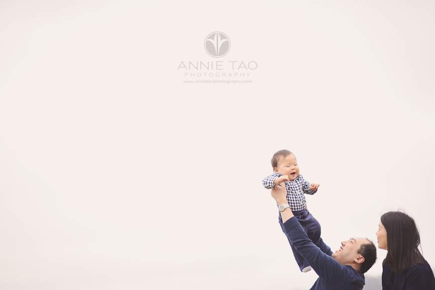 San-Francisco-lifestyle-baby-photography-family-of-three-lifting-baby-into-air