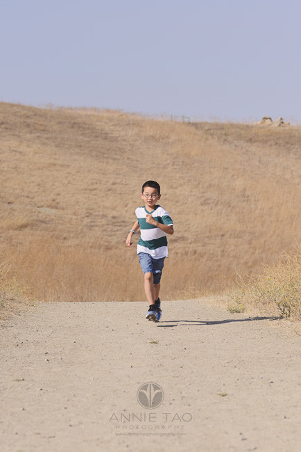 East-Bay-lifestyle-children-photography-young-boy-running-alongside-dirt-hill