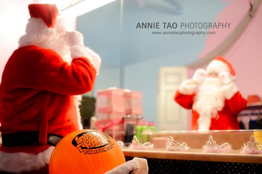 AnnieTao_SuperFranks_Santa-fixing-his-glasses-inside-castle