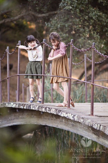 Bay-Area-lifestyle-children-photography-two-young-girls-standing-on-bridge
