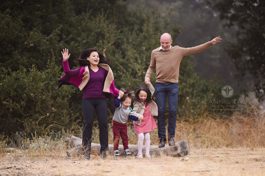 San-Francisco-Bay-Area-lifestyle-family-photography-jumping-together-from-log-in-the-fog