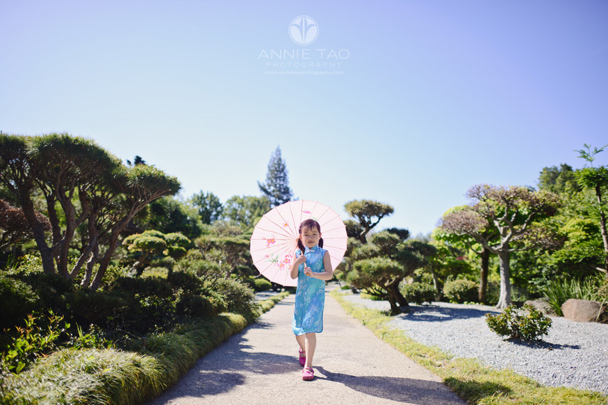 East-Bay-lifestyle-children-photography-young-girl-holding-umbrella-and-walking-through-Japanese-garden