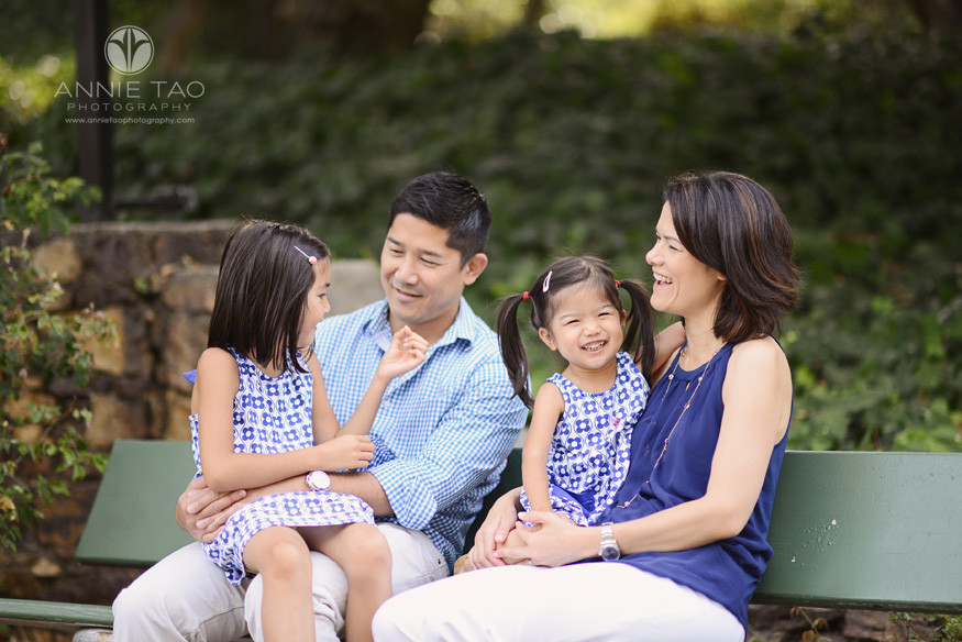 East-Bay-lifestyle-family-photography-laughing-family-spending-time-on-bench-closeup-view