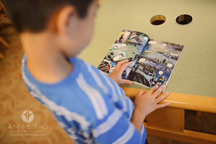 East-Bay-lifestyle-children-photography-library-young-boy-with-an-open-book-at-library