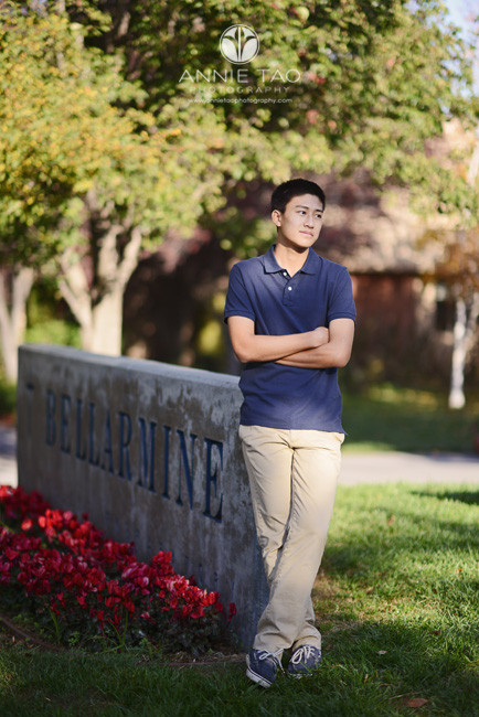 South-Bay-lifestyle-teen-photography-senior-boy-leaning-on-school-sign