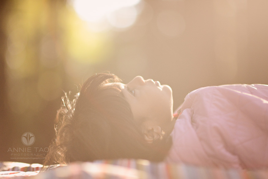 east-bay-lifestyle-children-photography-young-girl-laying-down-profile-in-sunflare