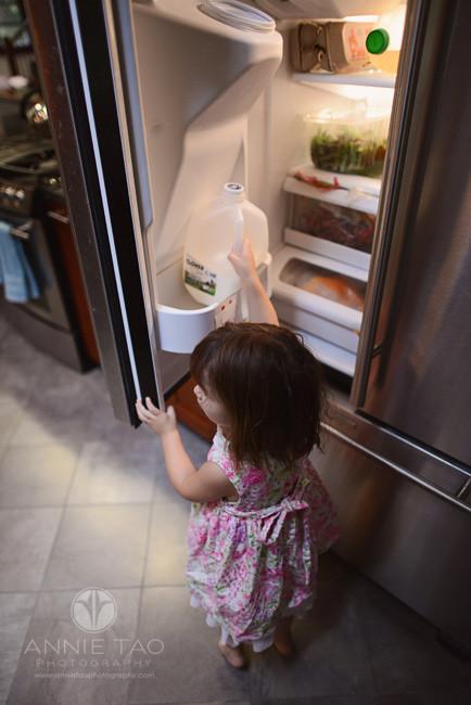 North-Bay-Marin-lifestyle-children-photography-toddler-girl-retrieving-milk-in-refrigerator