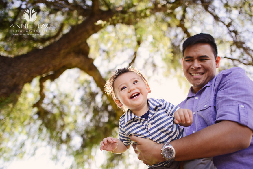 South-Bay-lifestyle-baby-photography-baby-playing-airplane-with-dad-by-tree