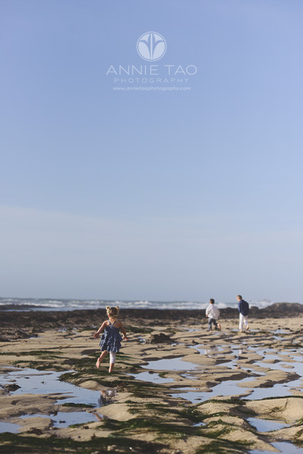 Bay-Area-Half-Moon-Bay-lifestyle-children-photography-younger-sister-running-behind-brothers-at-beach