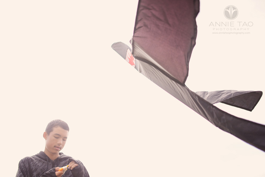San-Francisco-lifestyle-family-beach-photography-boy-reeling-in-kite