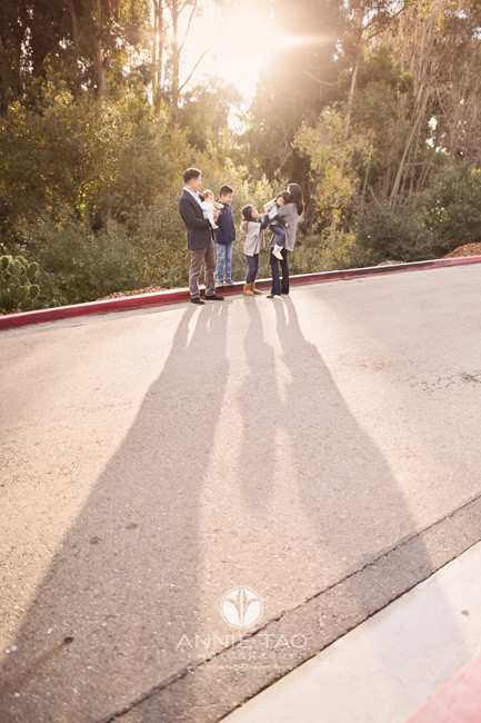 east-bay-lifestyle-family-photography-parents-with-four-kids-standing-with-extra-long-shadows