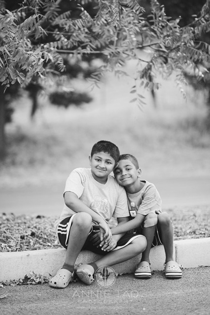 East-Bay-lifestyle-children-photography-brothers-sitting-in-parking-lot-BxW
