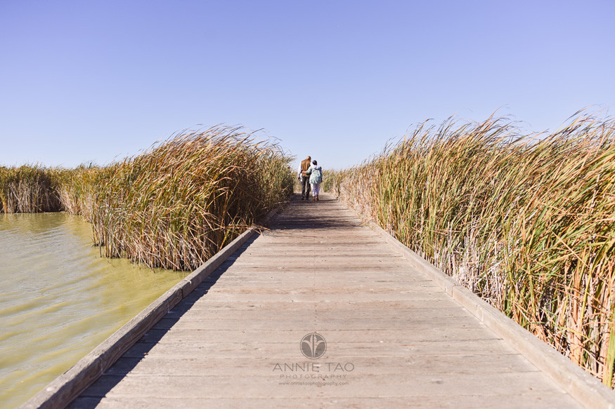 South-Bay-lifestyle-couple-photography-walking-away-on-walkway-in-marsh