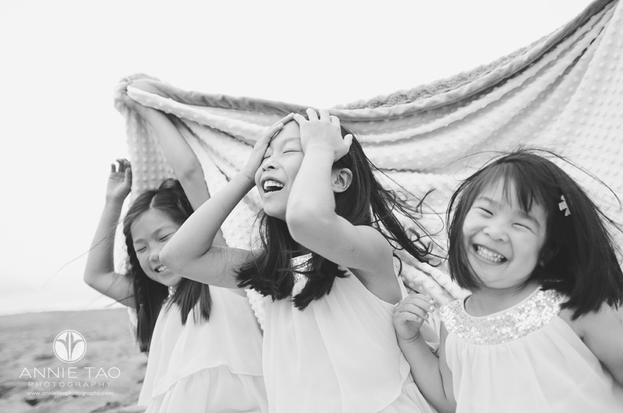 San-Francisco-Bay-Area-lifestyle-family-beach-photography-three-sisters-laughing-under-a-blanket-BxW