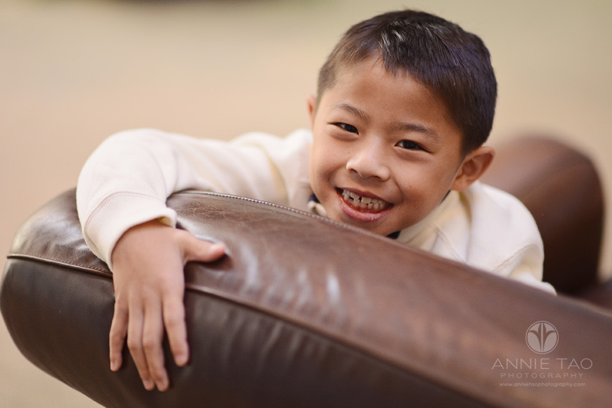 East-Bay-lifestyle-children-photography-young-boy-playing-on-leather-seat
