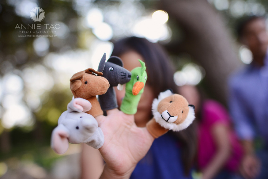 East-Bay-children-lifestyle-photography-child-holding-up-finger-puppets