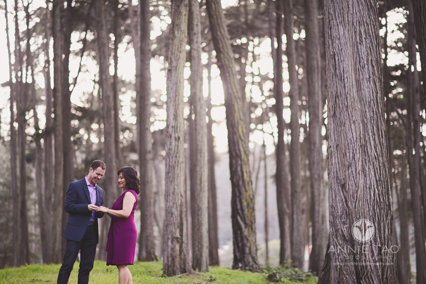 San-Francisco-lifestyle-engagement-photography-man-putting-diamond-ring-on-fiancees-finger-in-woods