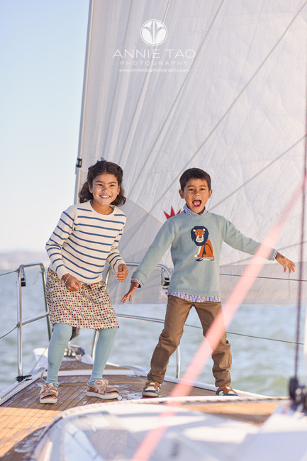 San-Francisco-lifestyle-children-photography-young-siblings-playing-on-sailboat-in-bay-3