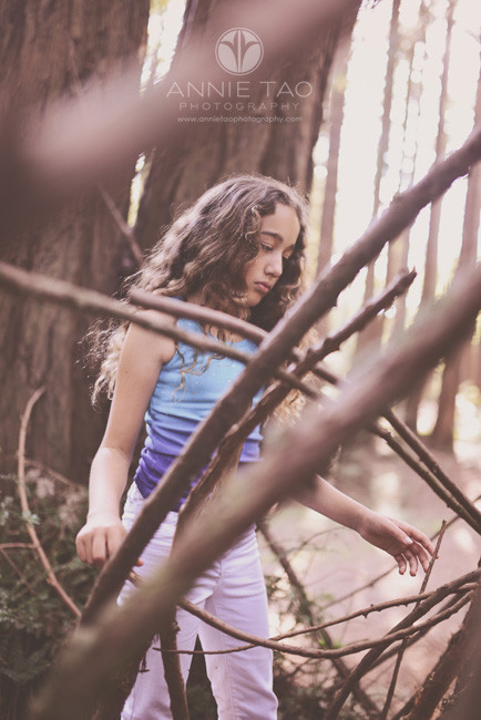 East-Bay-lifestyle-family-photography-girl-surrounded-by-branches-and-twigs