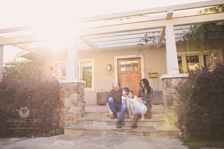 East-Bay-lifestyle-family-photography-family-hanging-out-on-steps-in-front-yard-with-sunflare
