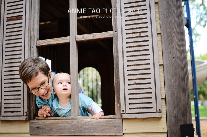 East-Bay-lifestyle-family-photography-baby-squishing-mommys-head-in-a-window