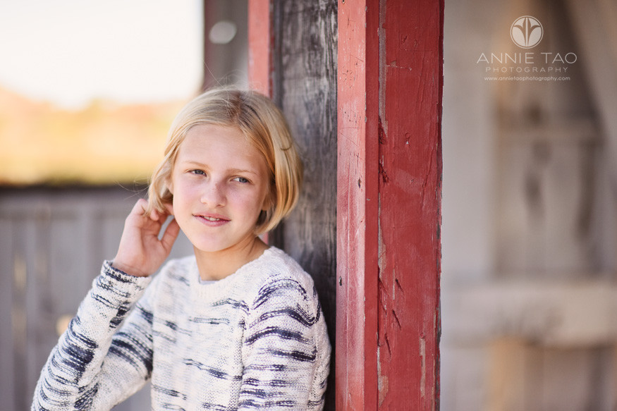 South-Bay-lifestyle-children-photography-girl-fixing-hair-by-red-fishing-hut