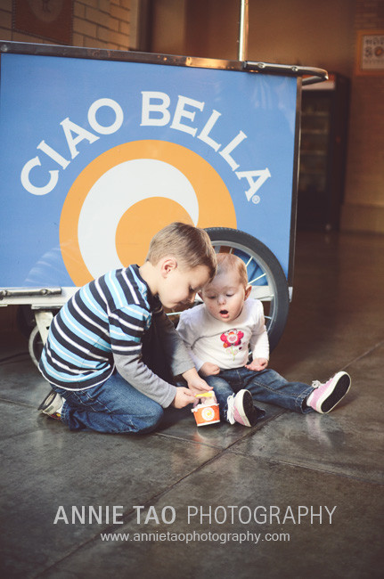 San-Francisco-Bay-Area-family-photography-big-brother-feeding-baby-sister-a-bite-of-ice-cream-Ferry-Building