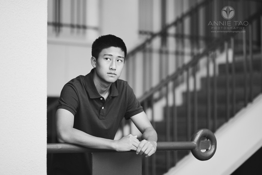 South-Bay-lifestyle-teen-photography-senior-boy-leaning-on-rail-BxW