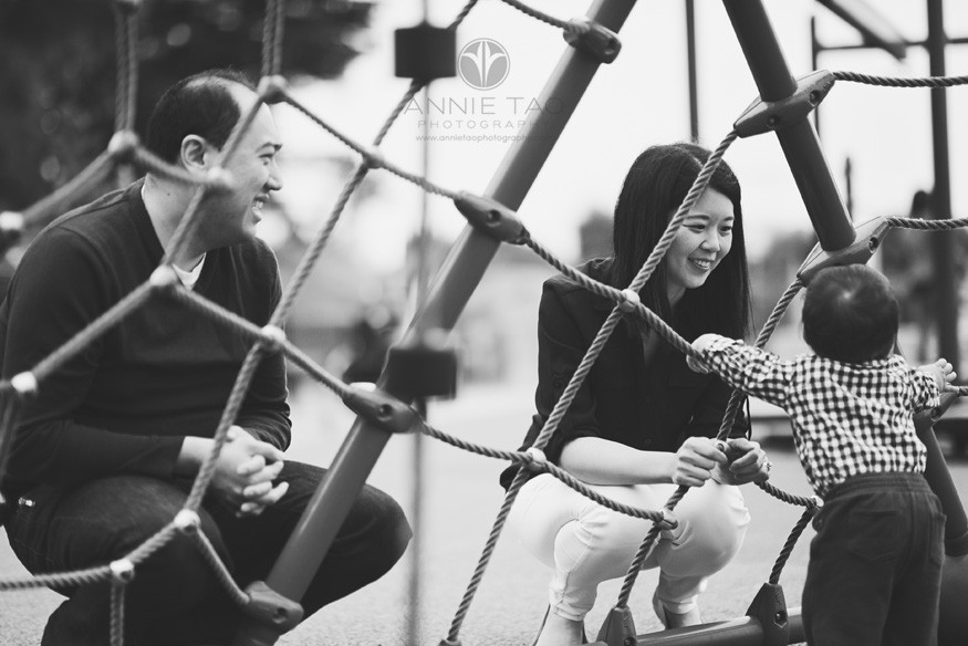 San-Francisco-lifestyle-family-photography-parents-looking-at-baby-through-play-structure-BxW