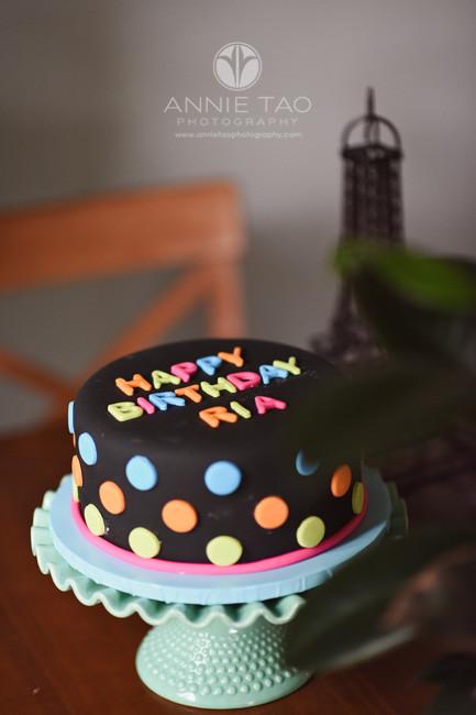 East-Bay-styled-photography-black-birthday-cake-on-parisian-table