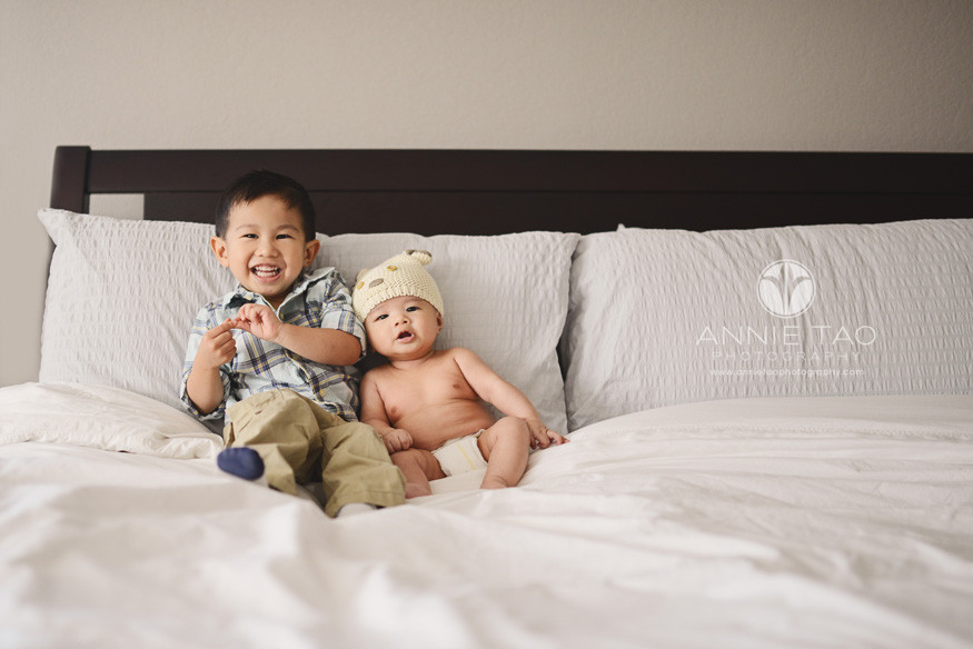 South-Bay-lifestyle-children-photography-toddler-brother-sitting-with-baby-brother-in-bed