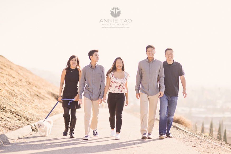South-Bay-lifestyle-teen-young-adult-photography-family-walking-on-hill-with-dog-and-glowy-sun