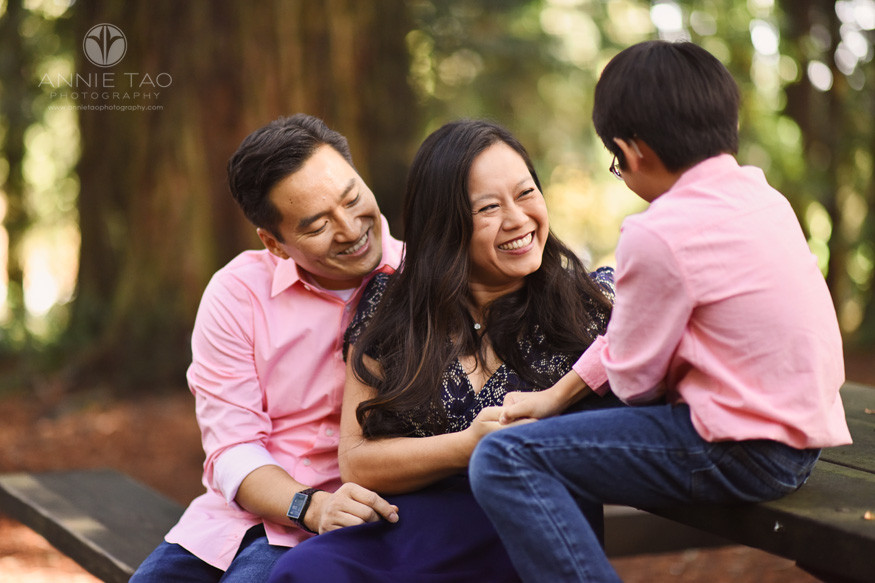East-Bay-lifestyle-family-photography-parents-smiling-at-son-in-forest