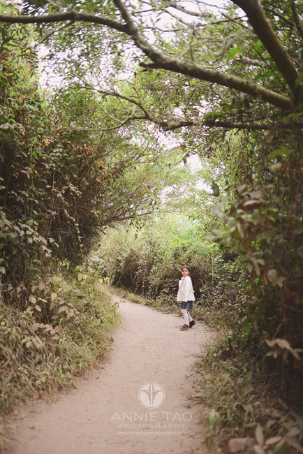 San-Francisco-lifestyle-children-photography-young-girl-walking-thru-tunnel-of-trees