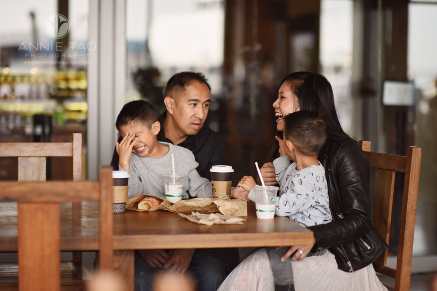 San-Francisco-lifestyle-family-photography-laughing-during-snack-break-ferry