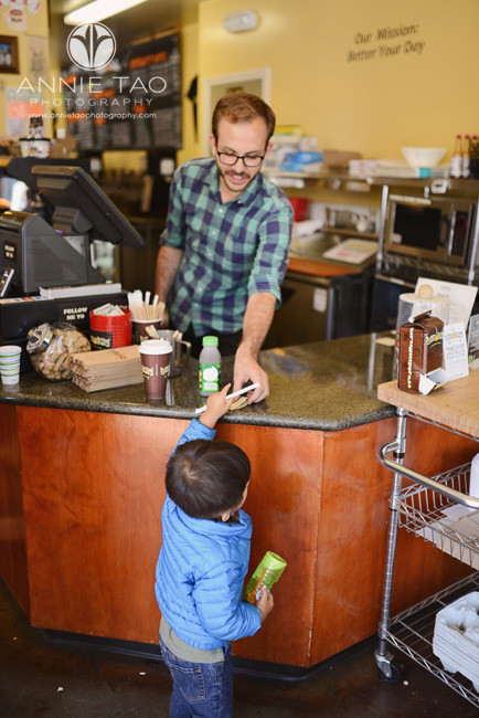 San-Francisco-lifestyle-children-photography-toddler-boy-paying-for-his-juice-at-a-coffee-shop