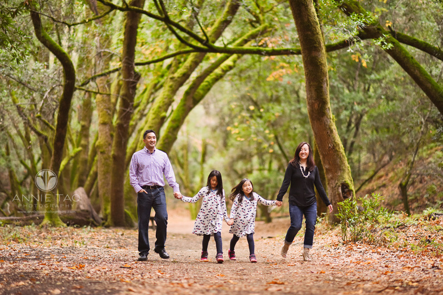 Bay-Area-lifestyle-family-photography-family-walking-together-in-magical-green-moss-lined-trees