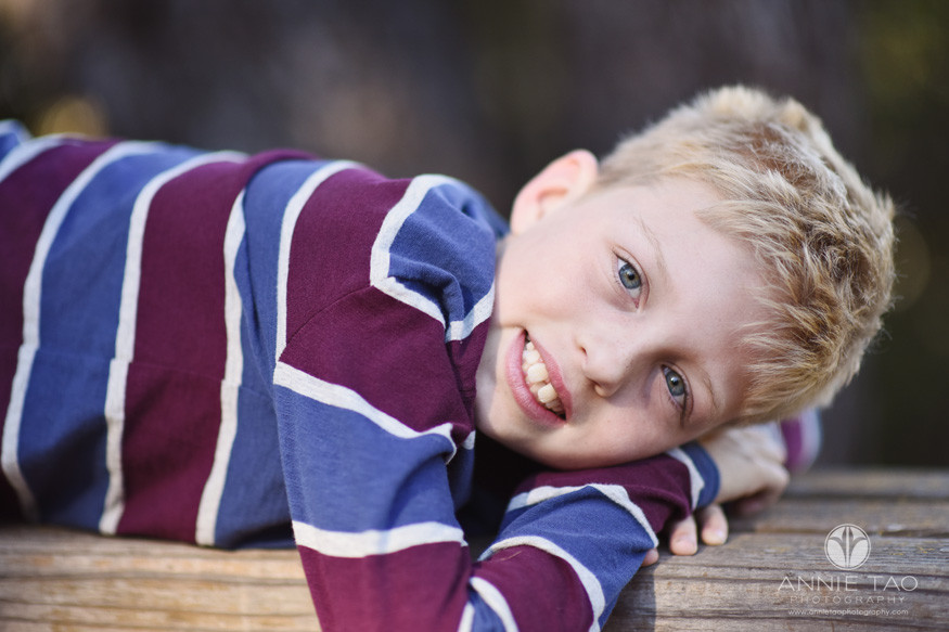 South-Bay-lifestyle-children-photography-young-boy-laying-down-closeup