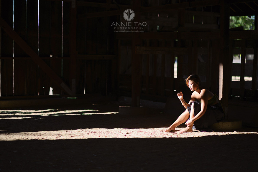 East-Bay-styled-photography-woman-with-short-hair-sitting-in-stripe-of-light