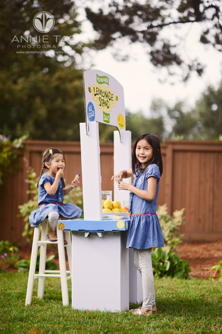 East-Bay-lifestyle-children-photography-two-young-girls-playing-lemonade-stand-backyard
