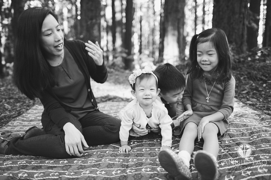 East-Bay-lifestyle-family-photography-mother-sitting-with-her-three-children-in-forest-BxW