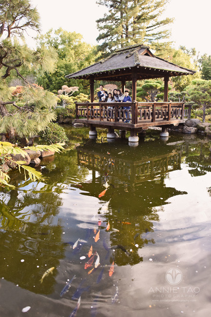 east-bay-lifestyle-family-photography-koi-fish-swimming-towards-camera-while-family-watches-at-japanese-garden