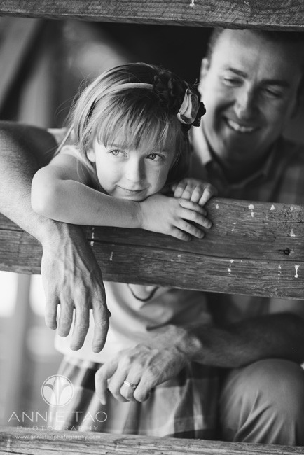 East-Bay-lifestyle-family-photography-father-looking-at-daughter-by-the-wooden-fence-BxW