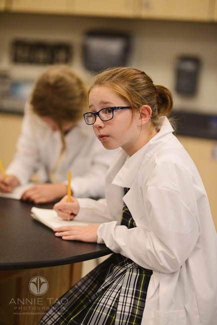 Commercial-education-photography-girl-wearing-glasses-and-lab-coat-in-science-class