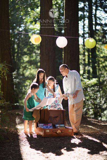 East-Bay-styled-family-photography-father-looking-at-maps-with-his-daughters