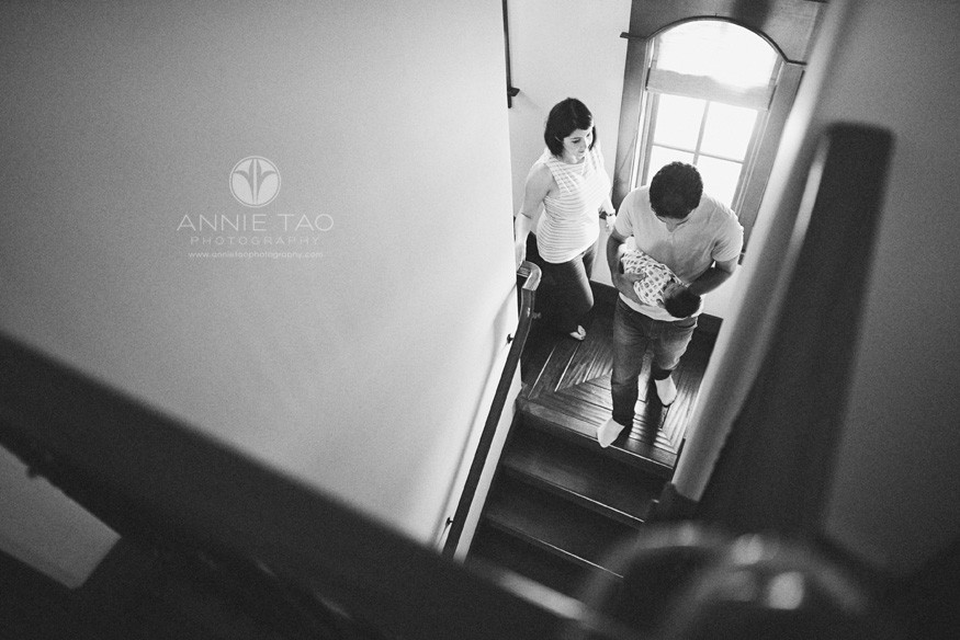 San-Francisco-Bay-Area-newborn-photography-parents-walking-downstairs-with-baby-BxW